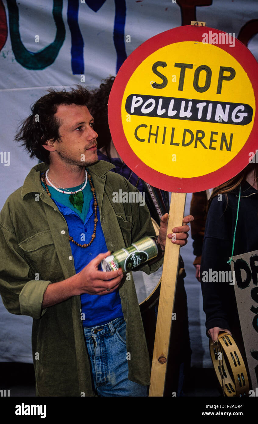 Protester holding Sign, Stop Polluting Children, Air Pollution Protest, London, England, UK, GB. - Stock Image