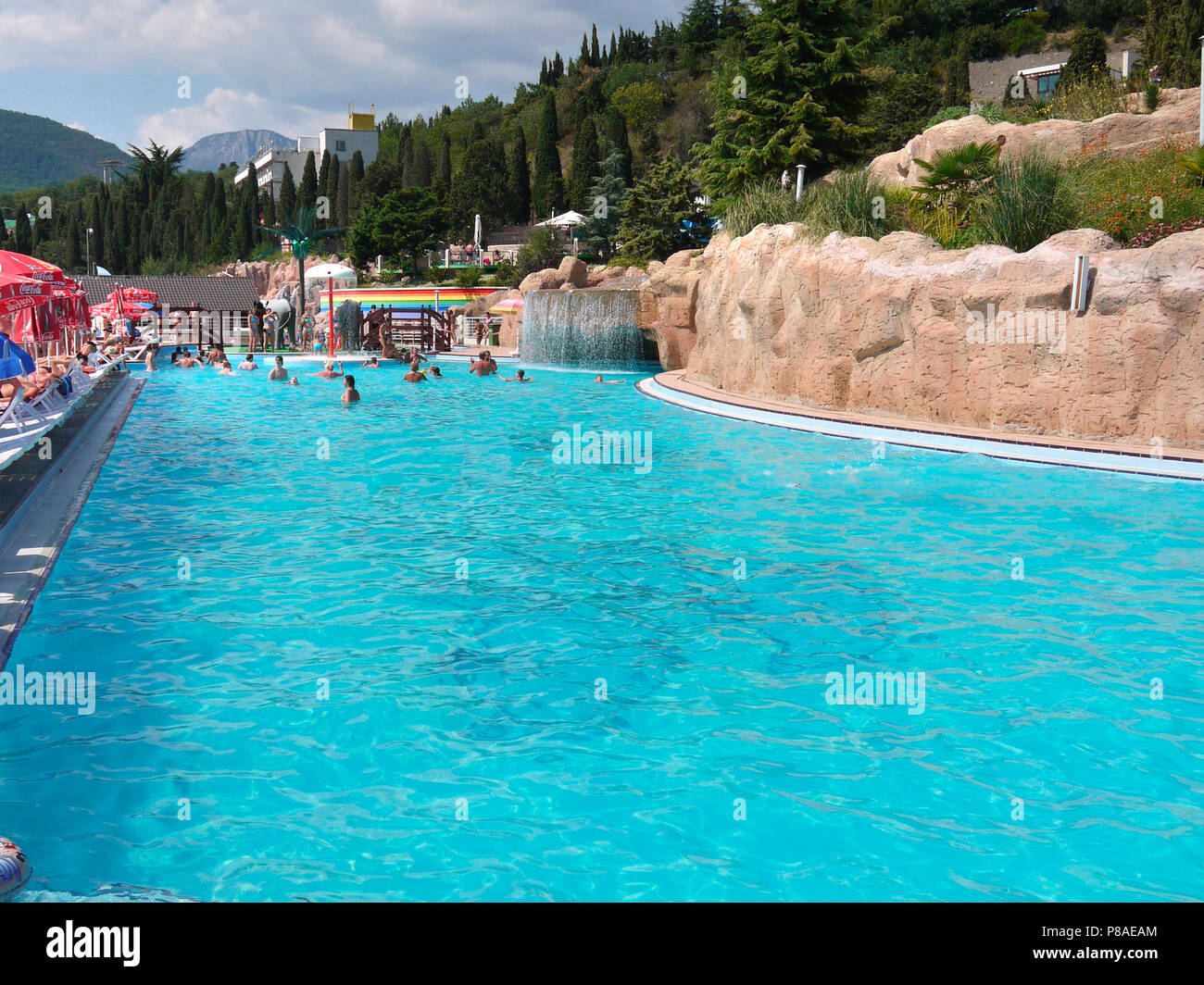 Beautiful Swimming Pool On The Territory Of Hotel With A Waterfall For Your Design