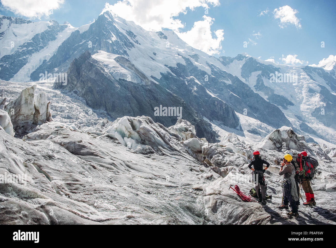 hikers standing and looking at beautiful mountains, Russian Federation, Caucasus, July 2012 - Stock Image