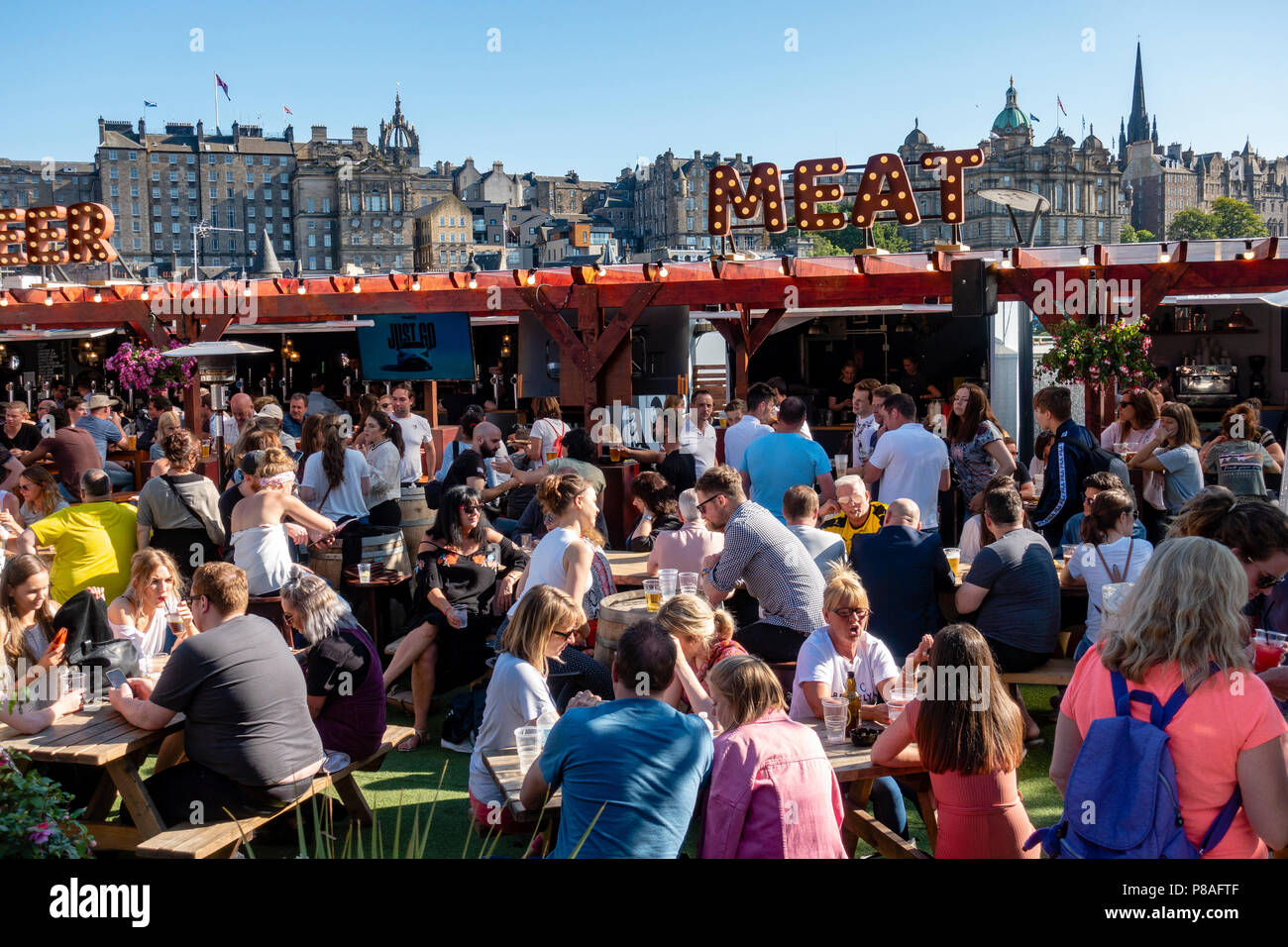 Busy outdoor bar in summer at Waverley Market shopping mall on Princes Street in Edinburgh, Scotland UK - Stock Image