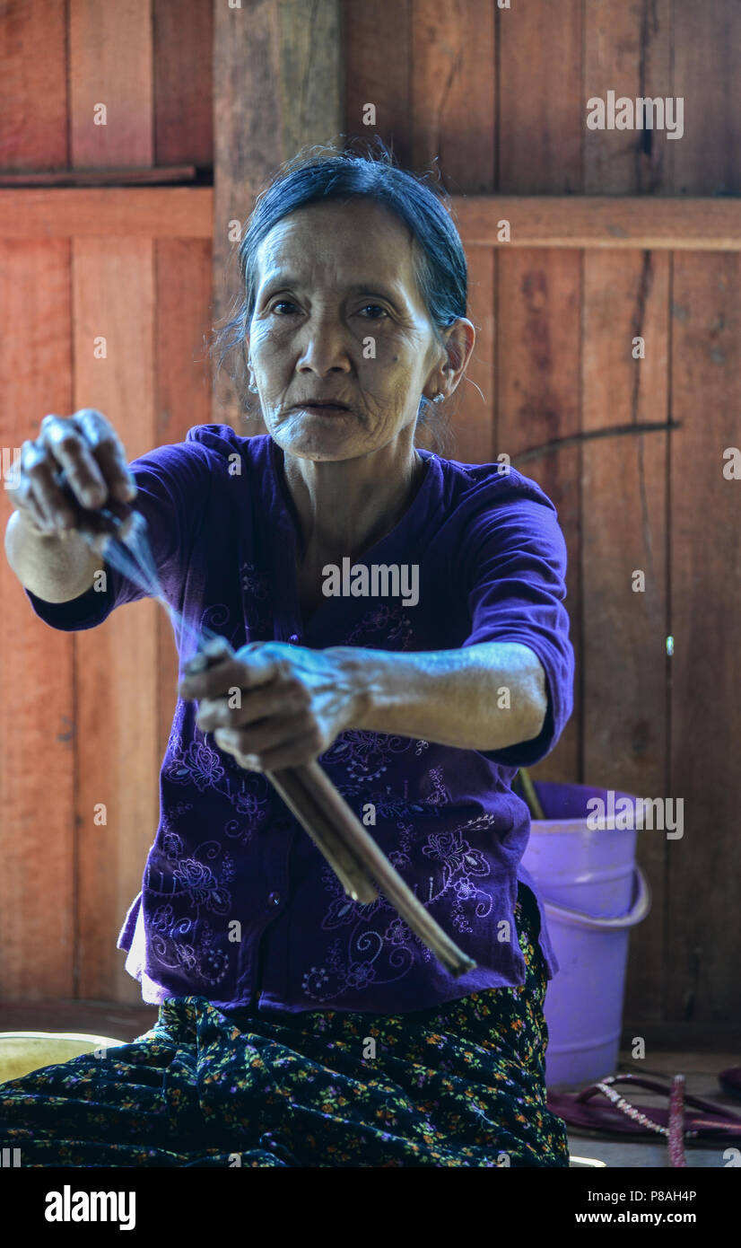 Inle Lake, Myanmar - Feb 7, 2018. A woman working at weaving factory on Inle Lake, Myanmar. The Inle lake area is renowned for its weaving industry. - Stock Image