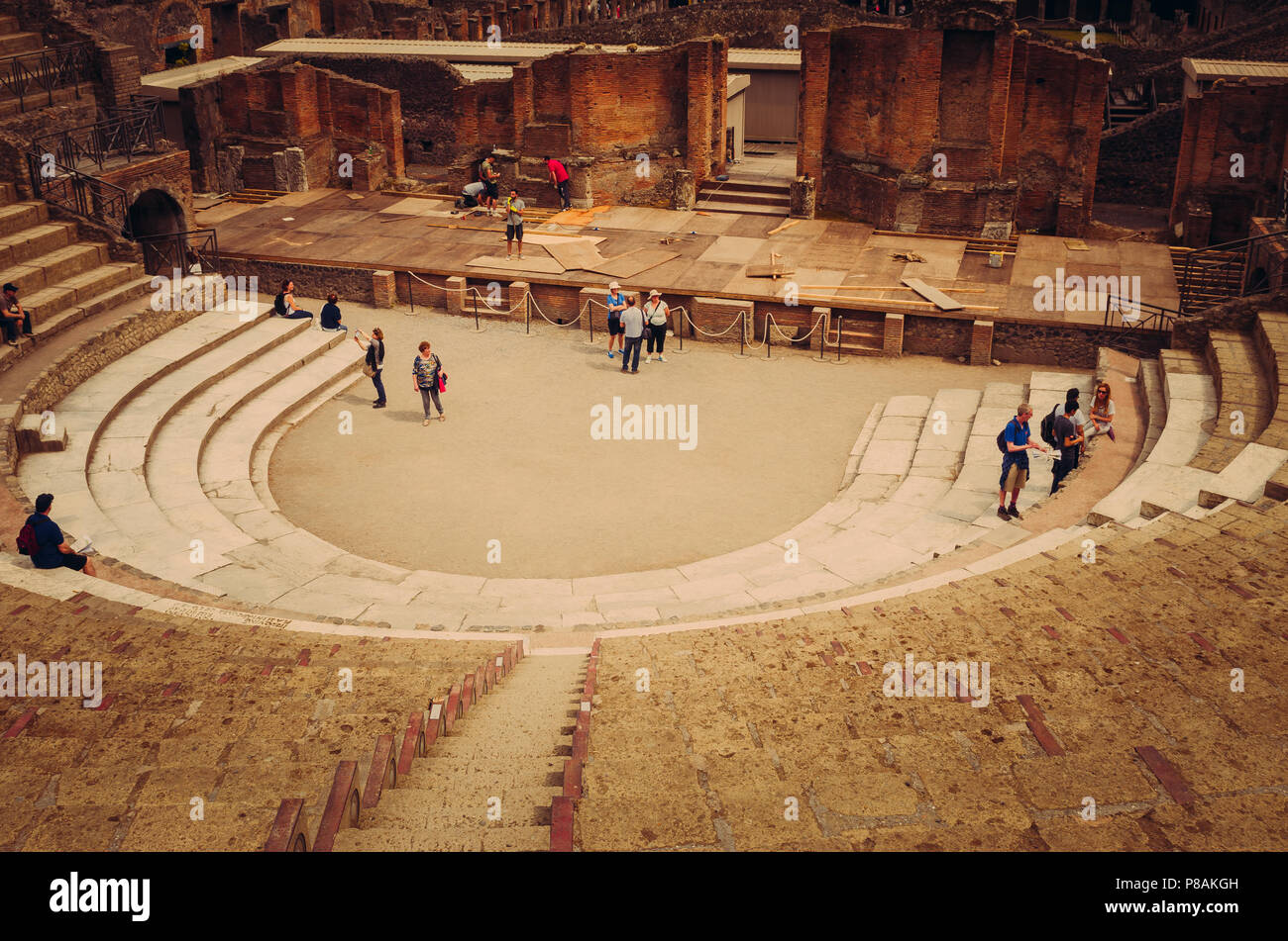 Tourists about the ancient Pompeii theater - Stock Image