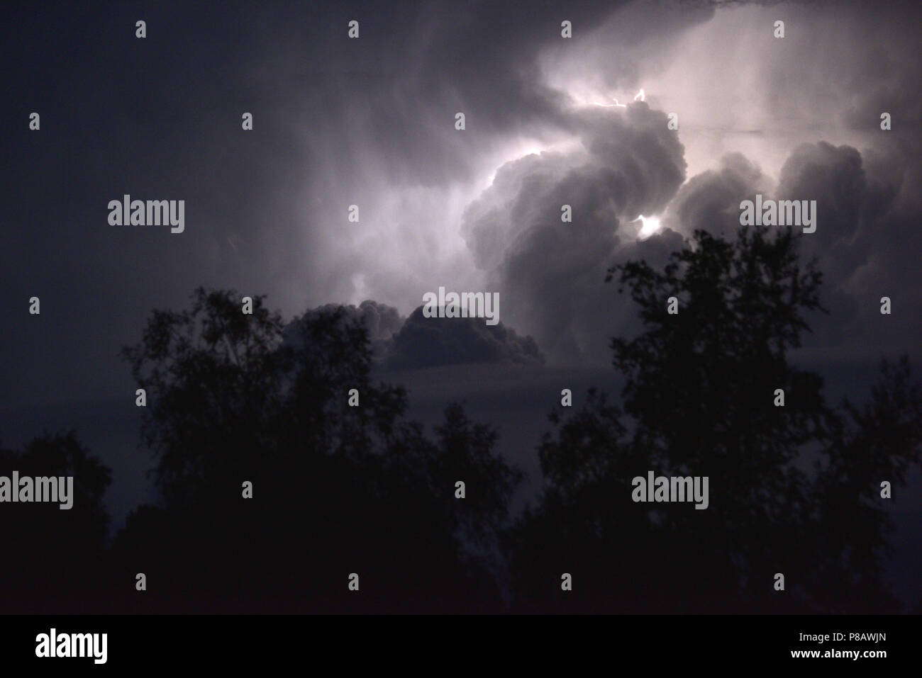 Thunder storm - Cumulonimbus clouds with lightning - Stock Image