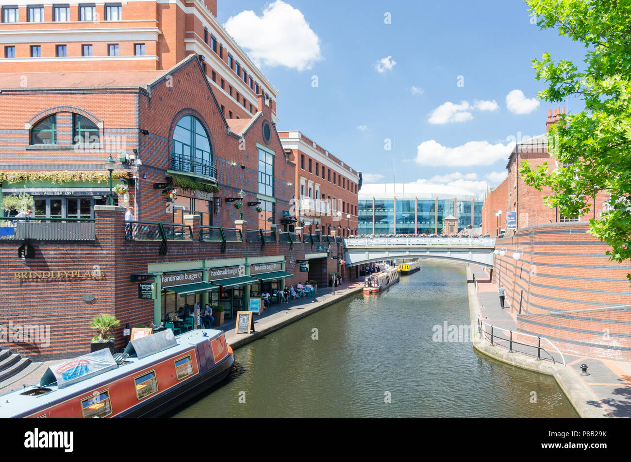 Canal running through Brindley Place in Birmingham City centre on a warm summer day - Stock Image
