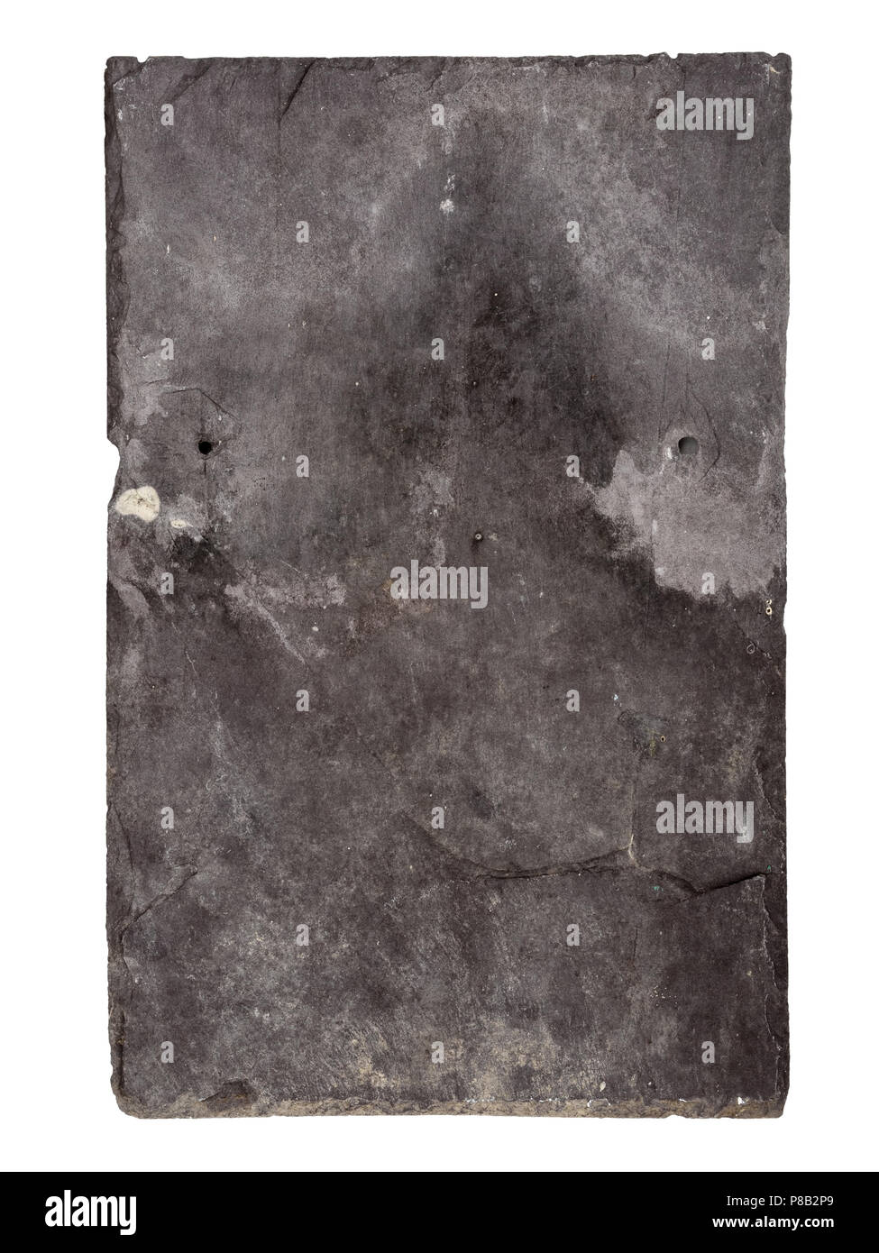 Genuine old slate stone roof tile with real signs of age isolated on white background. - Stock Image
