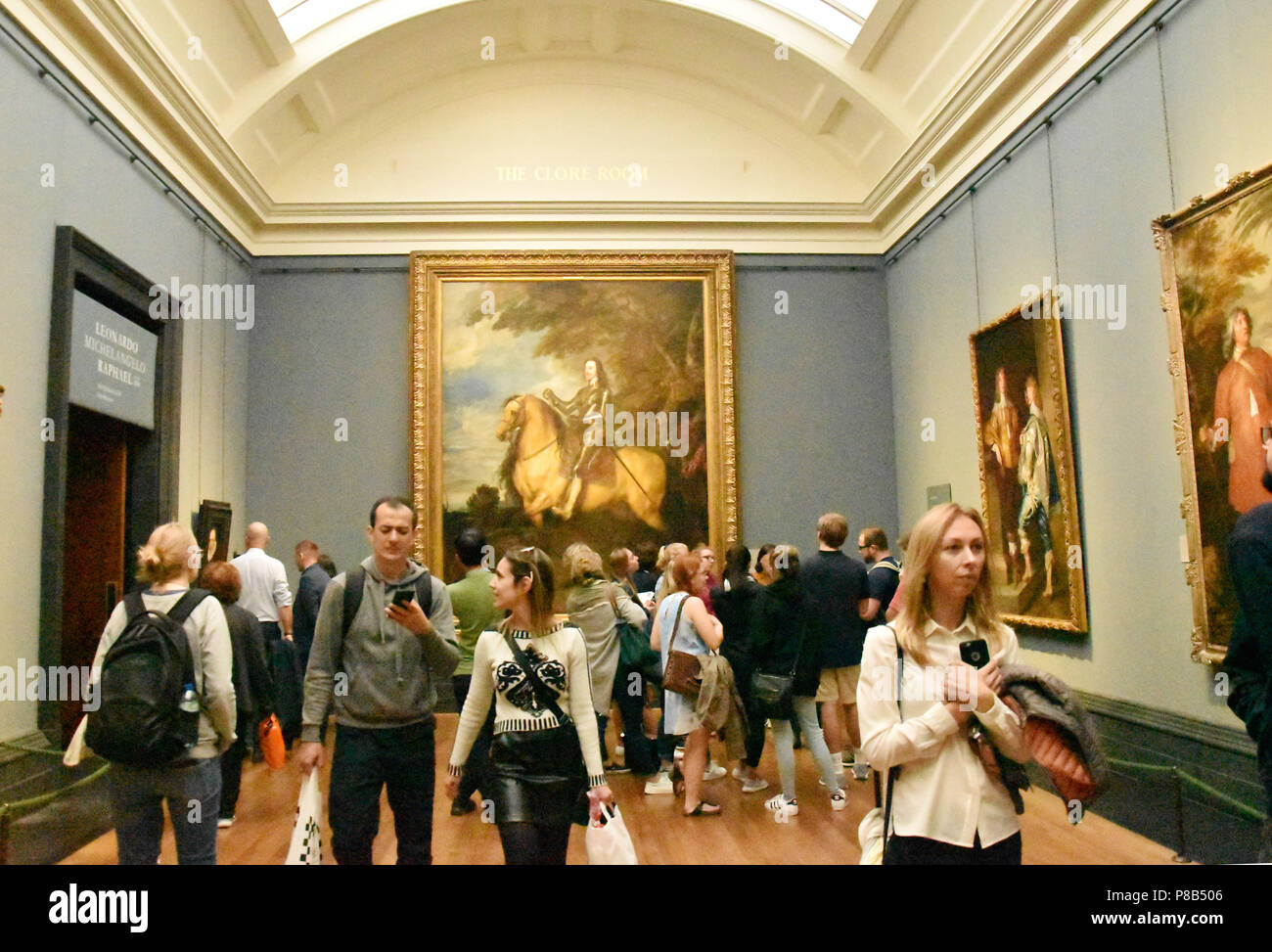 People in the galleries of the National Gallery, Trafalgar Square, London, UK. - Stock Image