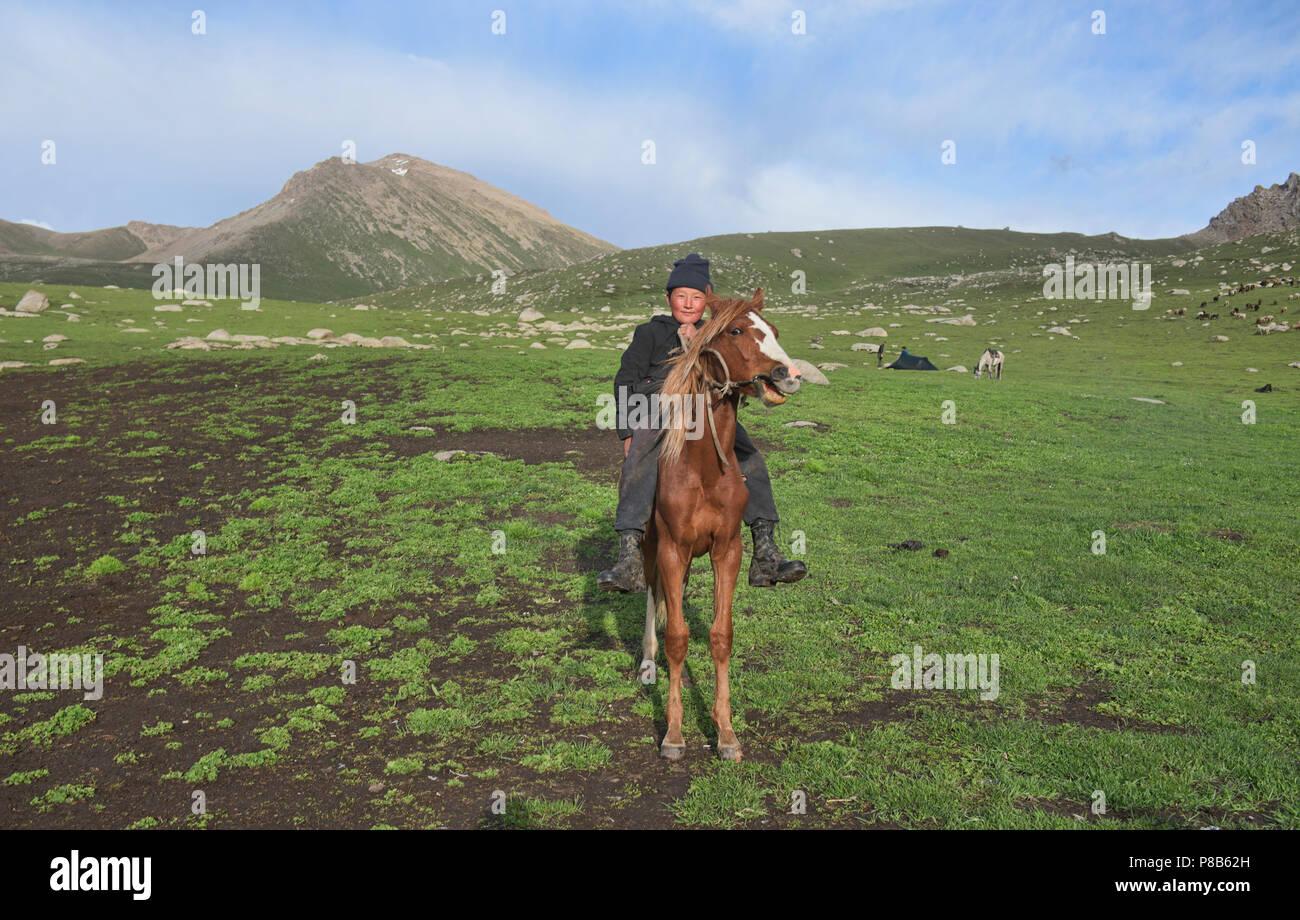 Kyrgyz horserider, Jyrgalan Valley, Kyrgyzstan Stock Photo