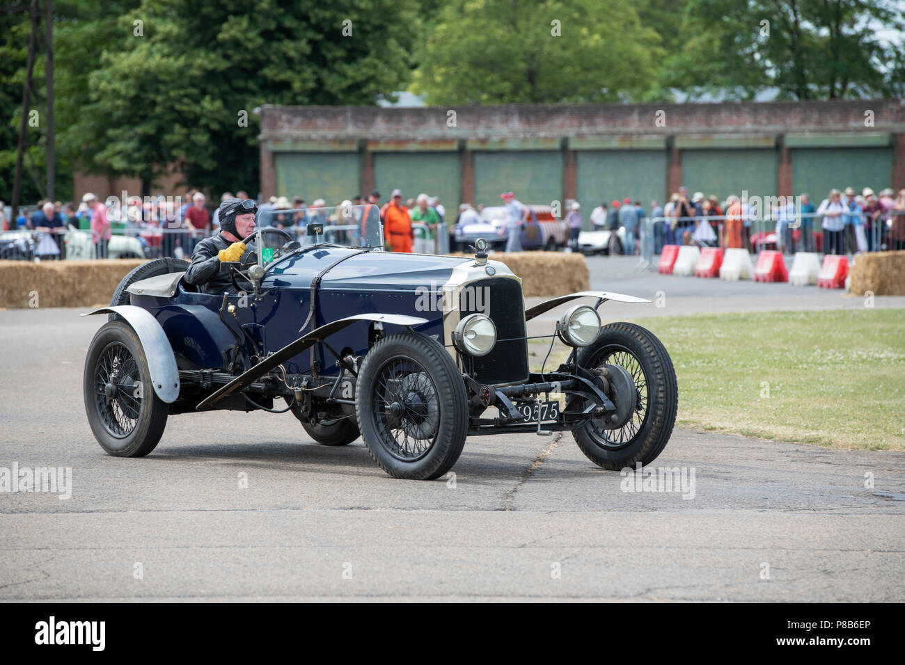1926 Vintage Vauxhall racing car driven around a track at the Bicester flywheel festival, Bicester Heritage centre, Oxfordshire, England - Stock Image