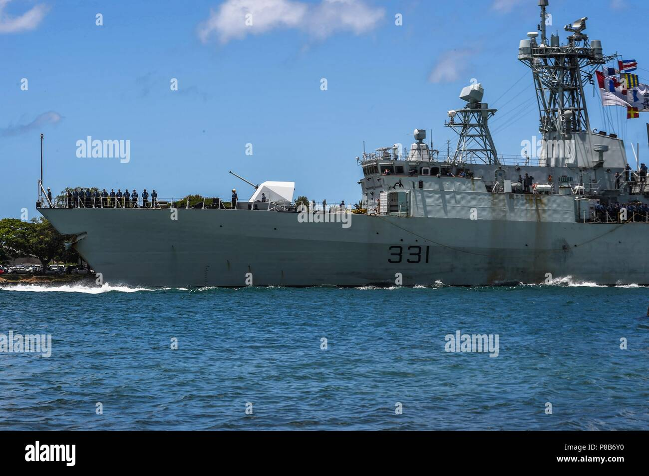 180625-N-FV745-0040 PEARL HARBOR (June 25, 2018) Royal Canadian Navy frigate HMCS Vancouver (FFH 331) arrives at Joint Base Pearl Harbor-Hickam in preparation for RIMPAC 2018, June 25, 2018. Twenty-five nations, more than 45 ships and submarines, about 200 aircraft and 25, 000 personnel are participating in RIMPAC from June 27 to Aug. 2 in and around the Hawaiian Islands and Southern California. The world's largest international maritime exercise, RIMPAC provides a unique training opportunity while fostering and sustaining cooperative relationships among participants critical to ensuring the s - Stock Image