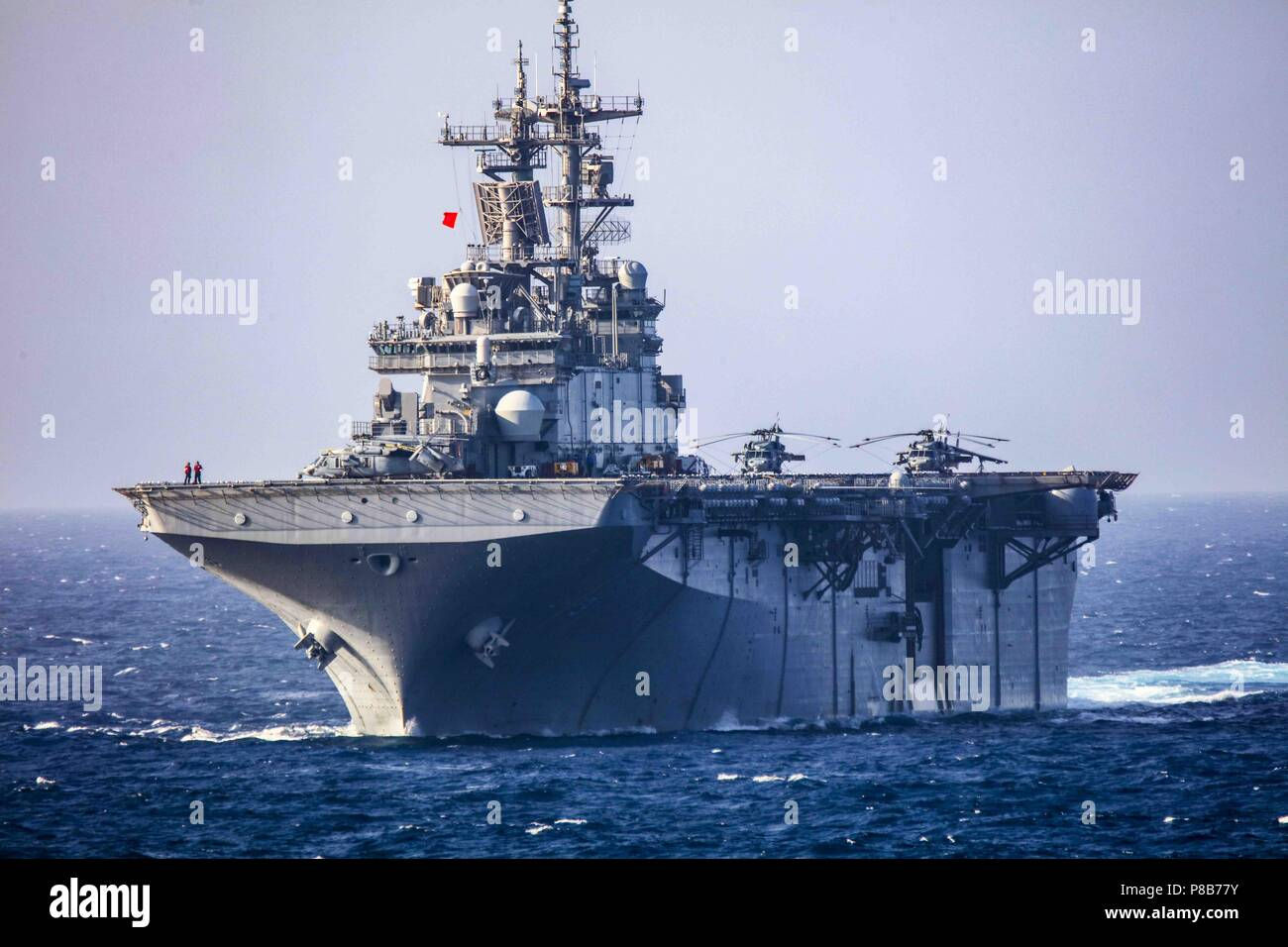 180623-N-VB2976-012 (ATLANTIC OCEAN) The Wasp-class amphibious assault ship USS Kearsarge (LHD 3) maneuvers during a live fire weapons exercise, June 23, 2018. Kearsarge Amphibious Ready Group (ARG) is completing the Navy's first East Coast ARG Surface Warfare Amphibious Tactical Training (SWATT) exercise. SWATT is led by the Naval Surface and Mine Warfighting Development Center (SMWDC) and is designed to increase warfighting proficiency, lethality and interoperability of participating units. (U.S. Navy photo by Mass Communication Specialist 3rd Class Kohen S. Gillis/Released). () - Stock Image