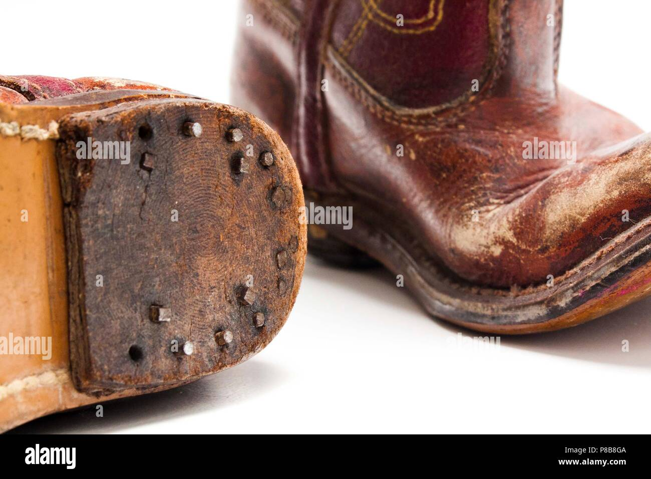 c3b5be3f2f5 Worn Out Cowboy Boots Stock Photos & Worn Out Cowboy Boots Stock ...