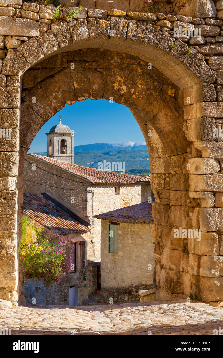 Stone gate in Lacoste with Mount Ventoux beyond, Provence France - Stock Image
