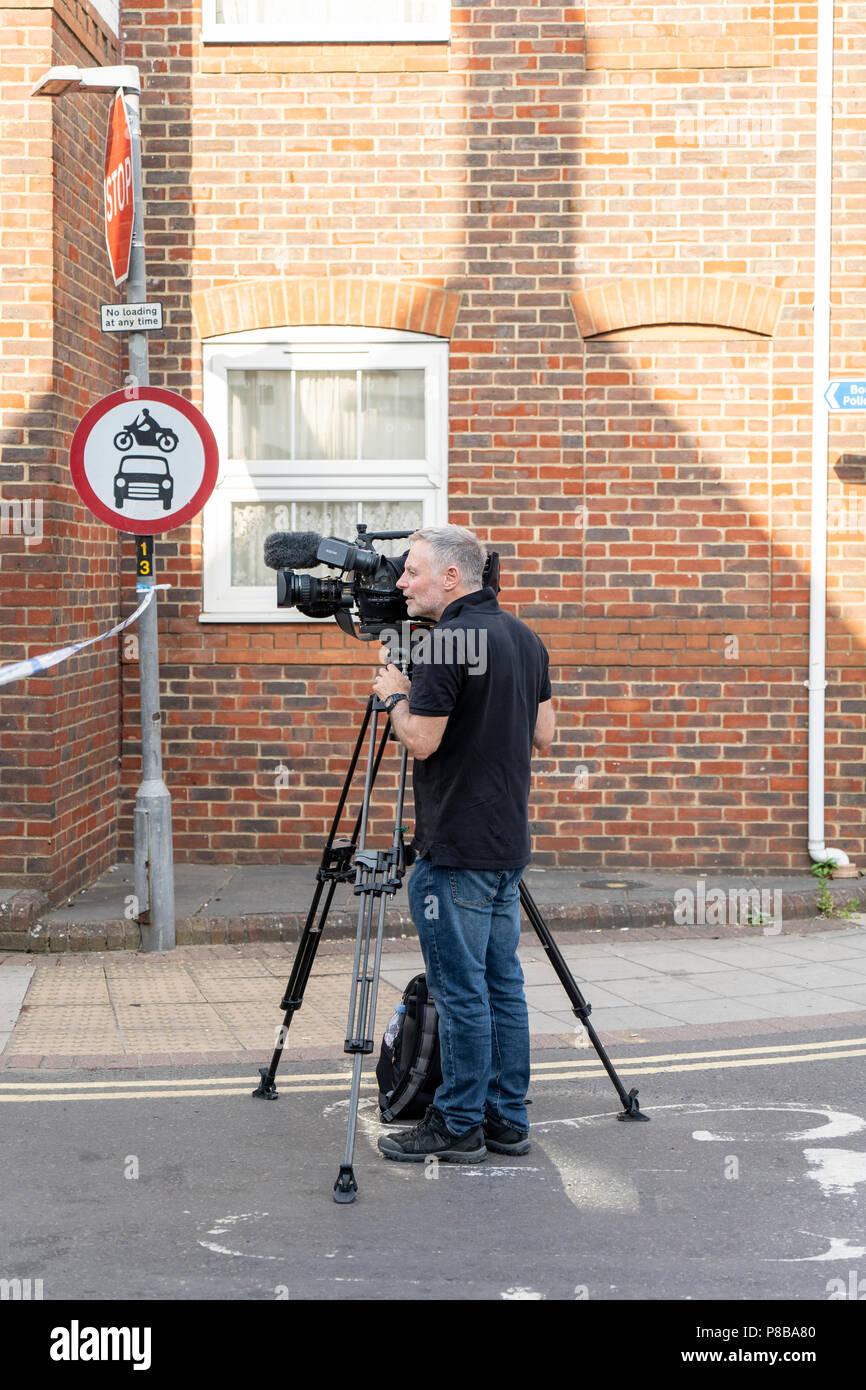 Cameraman in Rollestone Street Salisbury UK - Stock Image