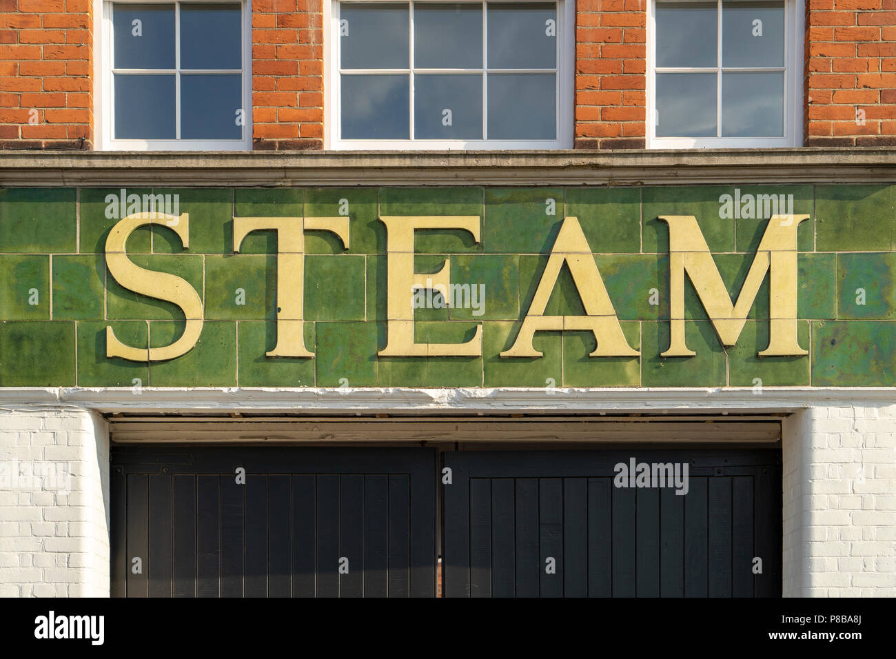 The word steam above a doorway - Stock Image