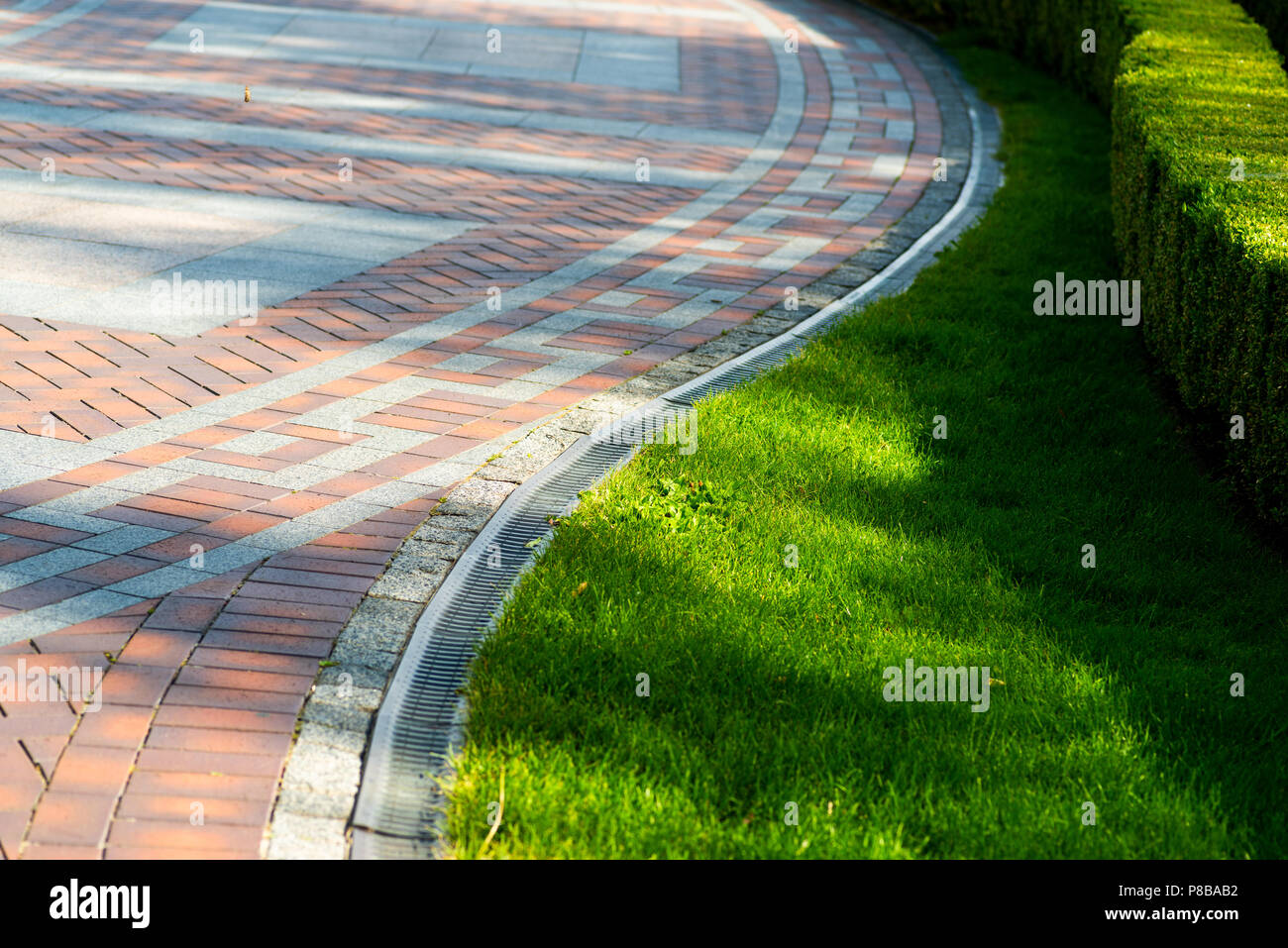 Pavement Tile And Shorn Grass In Landscape Design Stock Photo Alamy