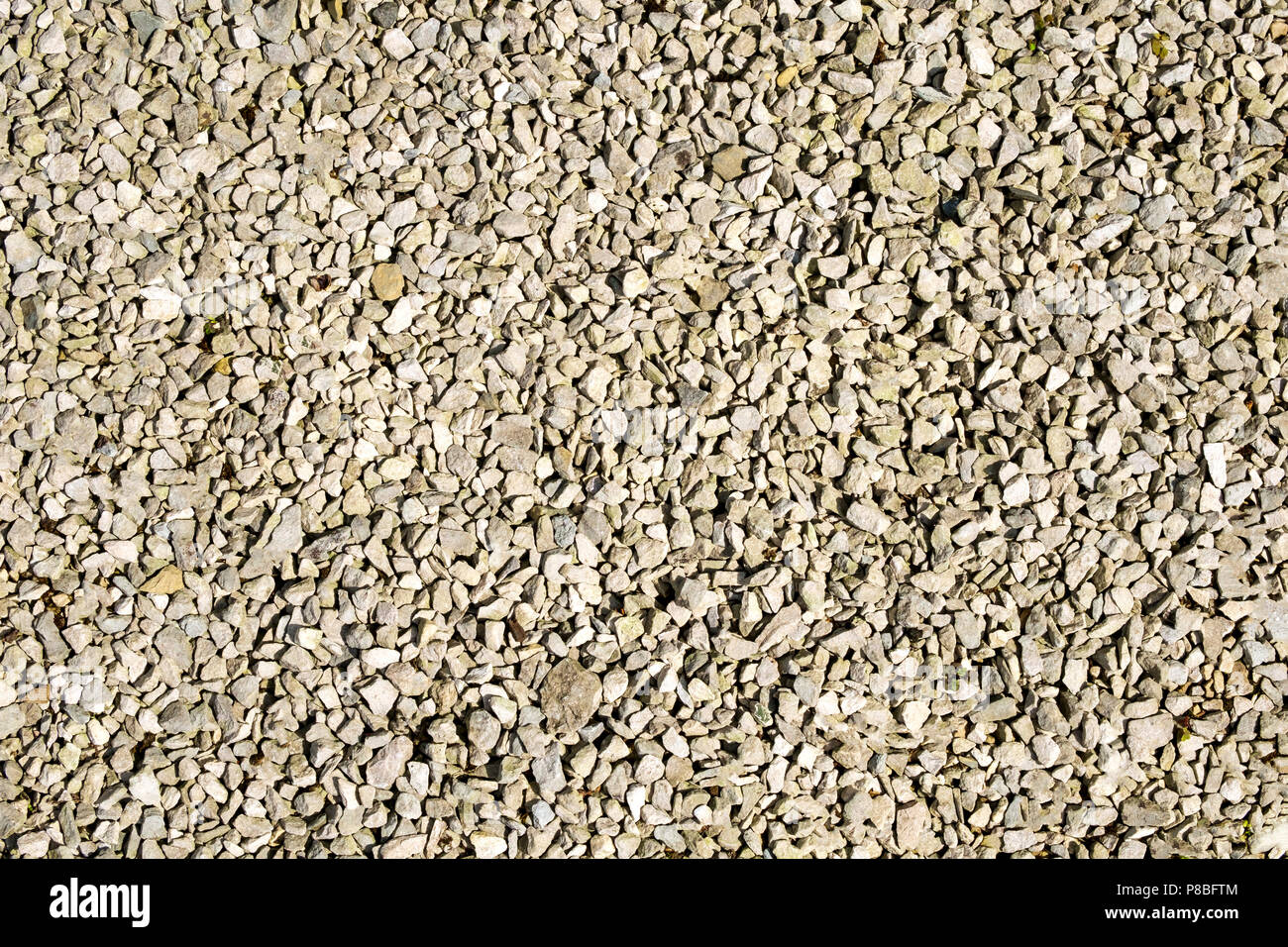 Limestone chippings hard landscaping garden surface - Stock Image