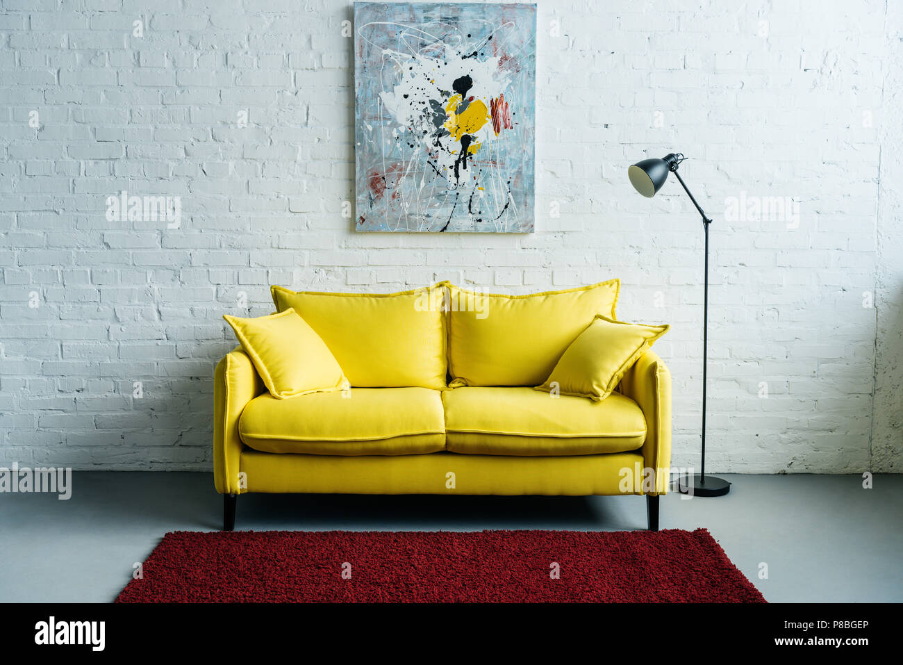 Interior Of Cozy Living Room With Painting On Wall, Sofa And Floor Lamp  Beside