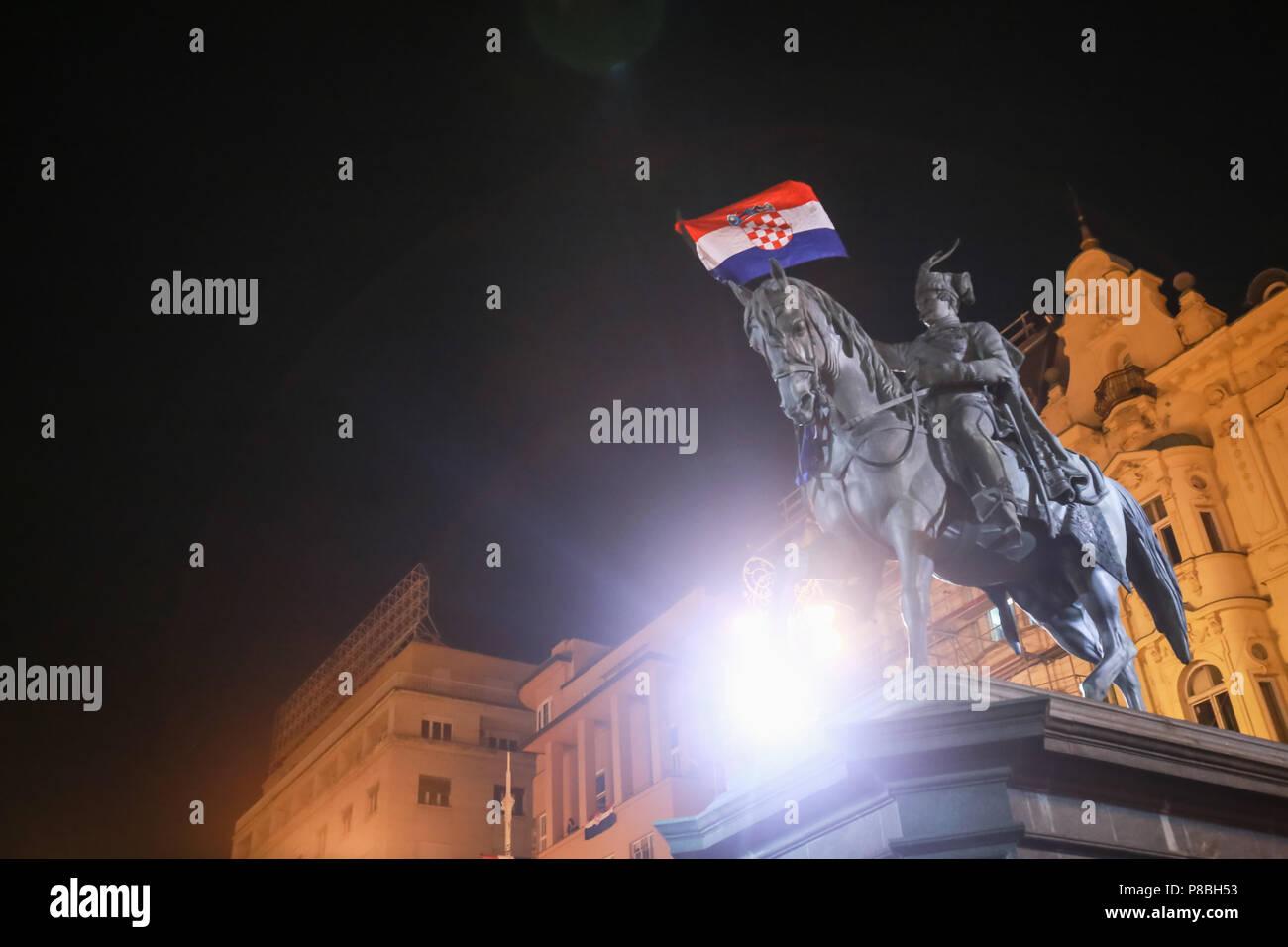ZAGREB, CROATIA - JULY 7TH, 2018 : Croatian football fans flagged the Croatian flag on the statue of Ban Josip Jelacic after win of Croatian national  Stock Photo