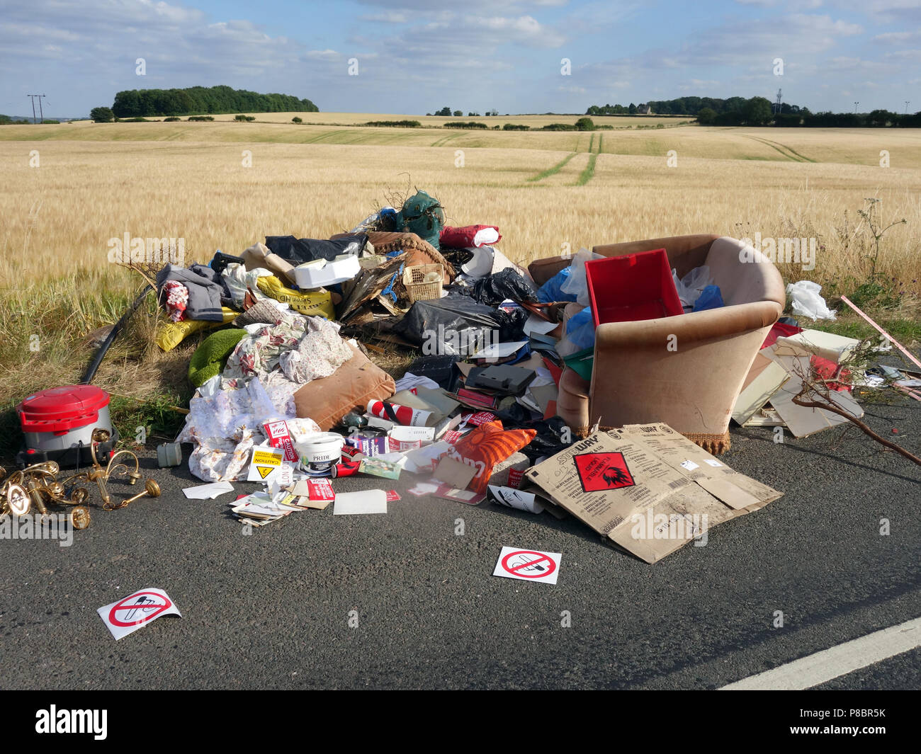 Lorry tipped rubbish all over the road by back off loading household rubbish into a lane in this picturesque part Dinnington, South Yorkshire - Stock Image