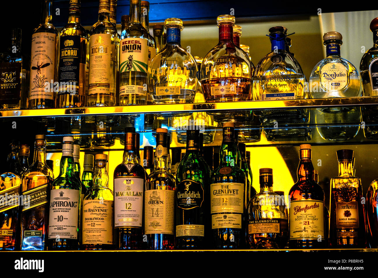 whiskey bottles on bar shelves Stock Photo: 211701649 - Alamy