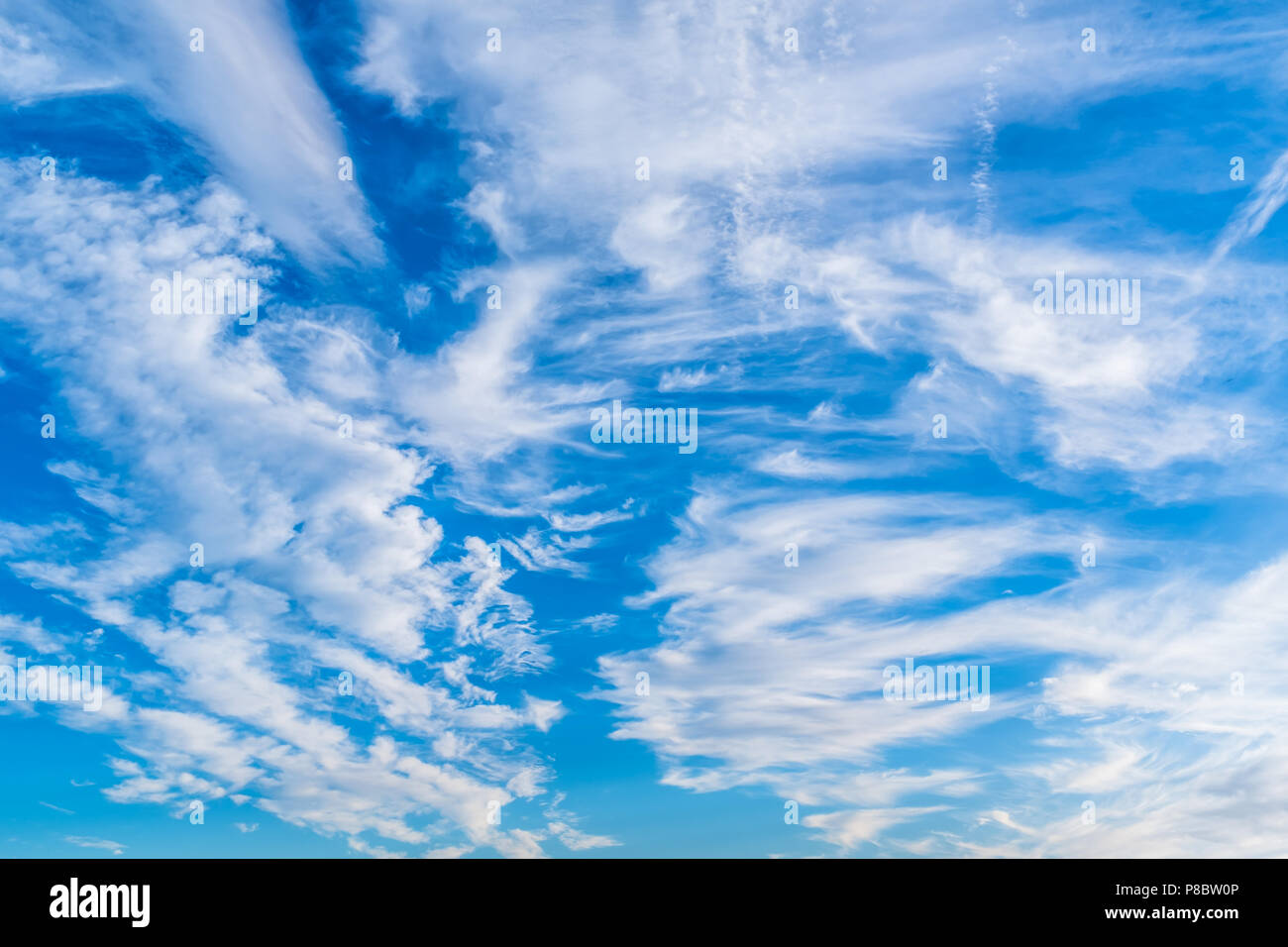 blue sky with white wispy cloud natural cloudscape background Stock Photo