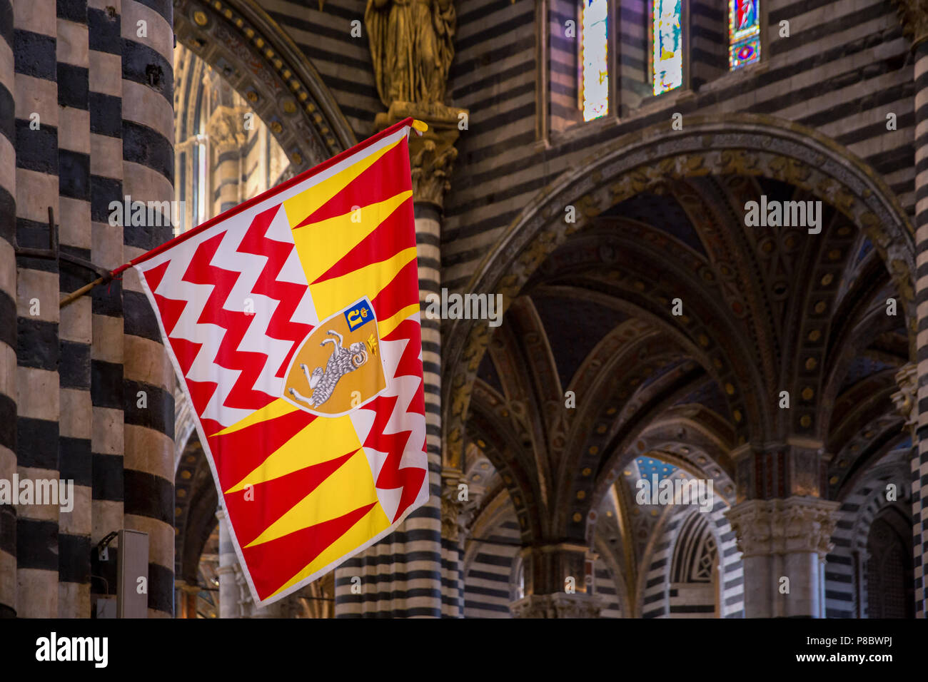 Dome of the Cathedral of Siena with a banner of Valdimontone, Cattedrale di Santa Maria Assunta, interior view, Siena, Tuscany, Italy Stock Photo