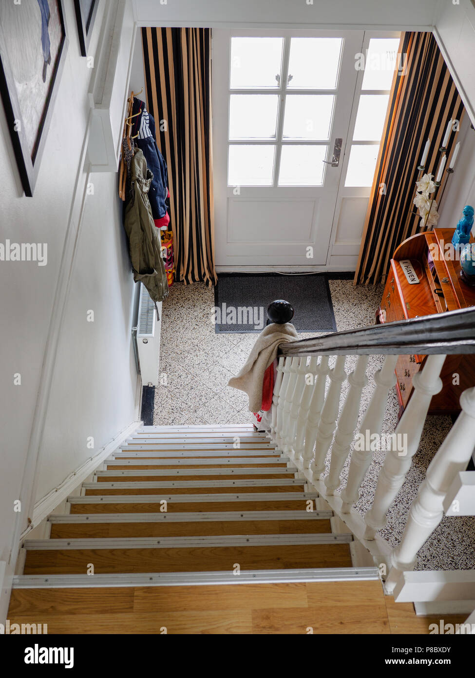 Interior staircase in front entrance of home, Aero Island, Denmark. - Stock Image