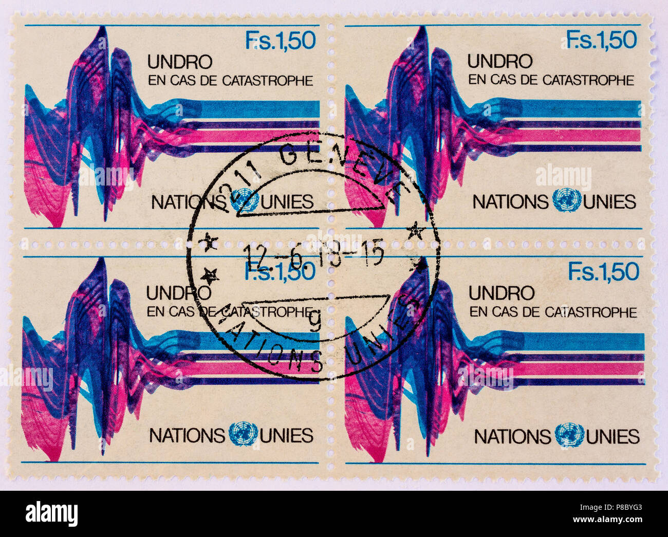 Block of 4 Swiss UNDRO stamps - United Nations Disaster Relief Organization. - Stock Image