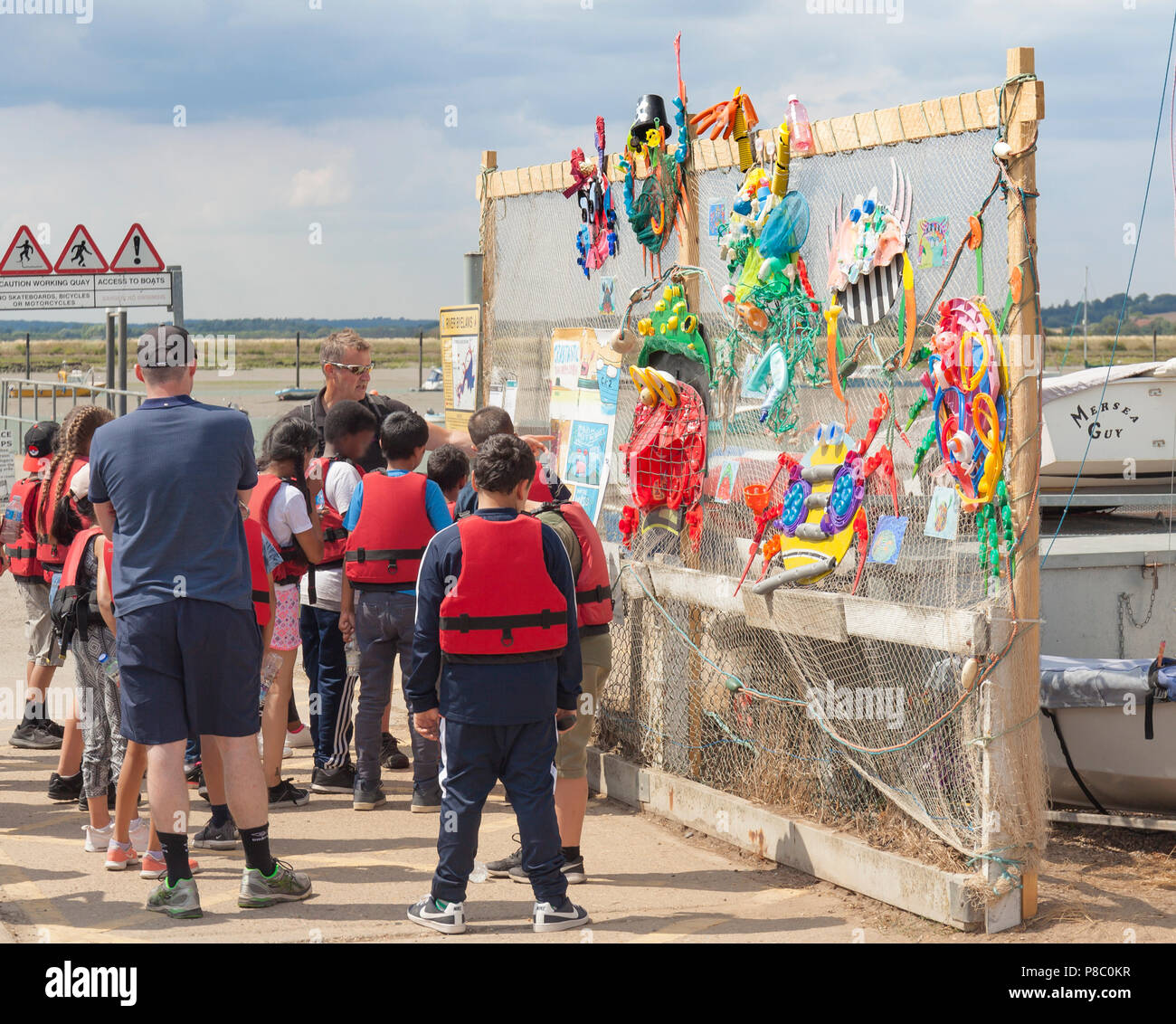 Group of school children on a day trip to Mersea Island, about to go crabbing. Stock Photo