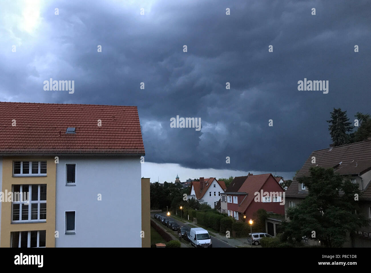Berlin, Germany, storm clouds over residential buildings Stock Photo