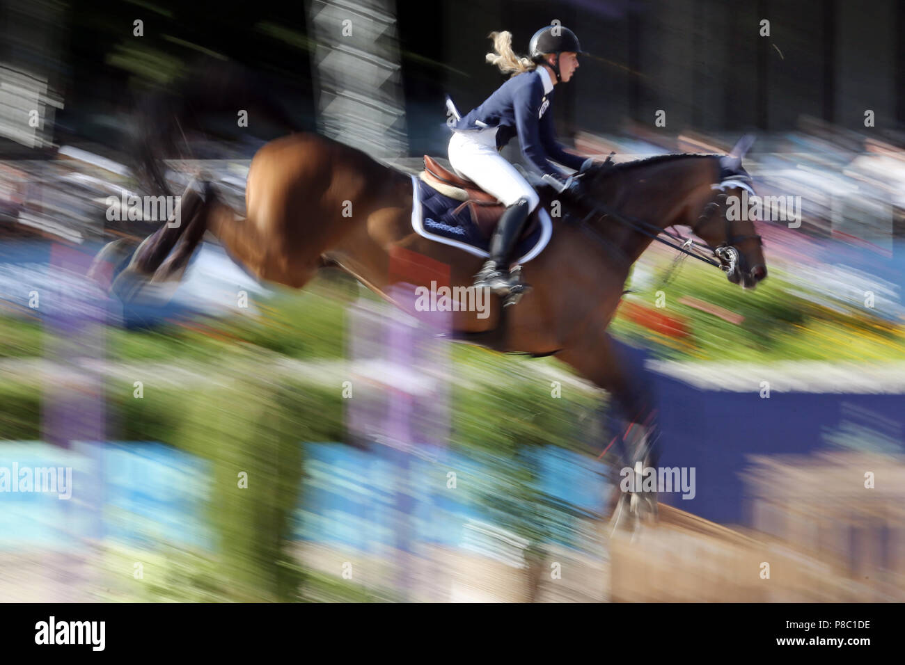 Berlin, dynamics, jumping horse and rider over an oxer. Silverstone G under Laura Klaphake (GER) - Stock Image
