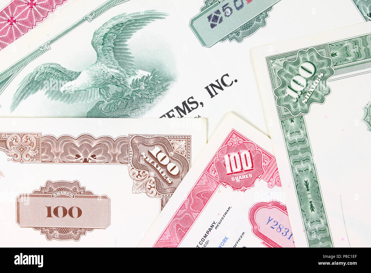 Stock market collectibles. Old stock share certificates from 1950s-1970s (United States). Vintage scripophily objects (obsolete). - Stock Image