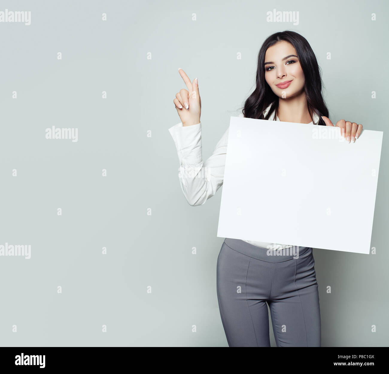 Cute Young Woman Student With White Blank Paper Banner Background With Copy Space Pointing Her Finger Business Startup Or Education Concept Stock Photo Alamy