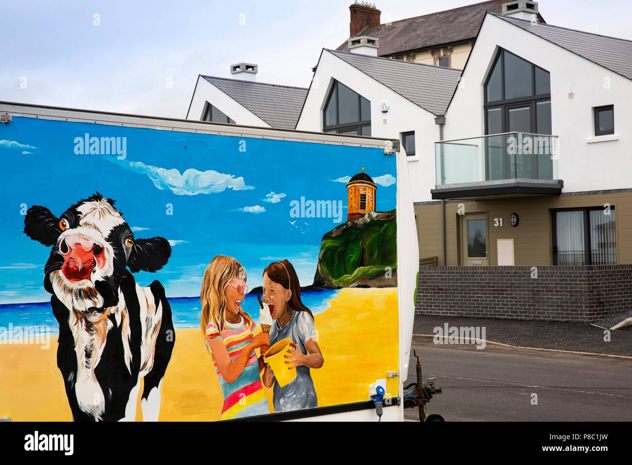 UK, Northern Ireland, Co Londonderry, Castlerock, painted ice cream van and seafront homes Stock Photo