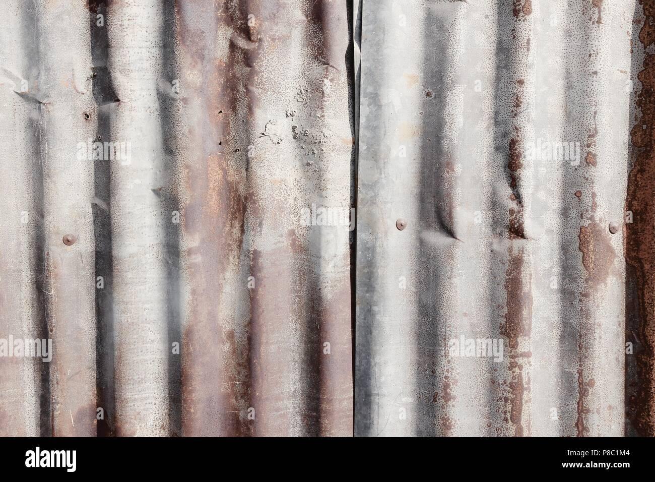 Galvanized metal texture - grungy old steel tin. - Stock Image