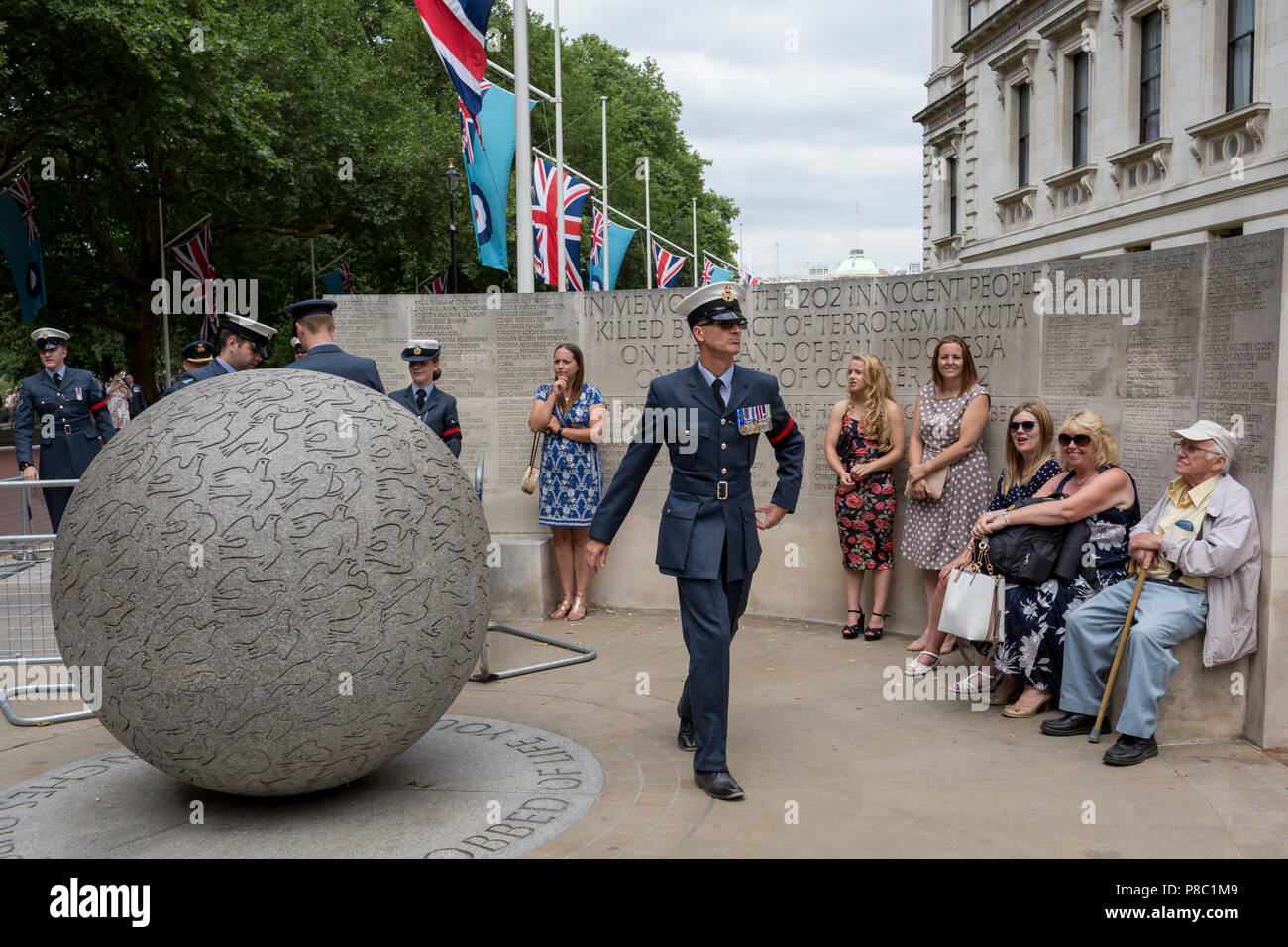 On the 100th anniversary of the Royal Air Force (RAF) and following a flypast of 100 aircraft formations representing Britain's air defence history which flew over central London, a serviceman leaves Horseguards, passing the memorial to those killed in the 2002 Bali bombing, on 10th July 2018, in London, England. (Photo by Richard Baker / In Pictures via Getty Images) - Stock Image