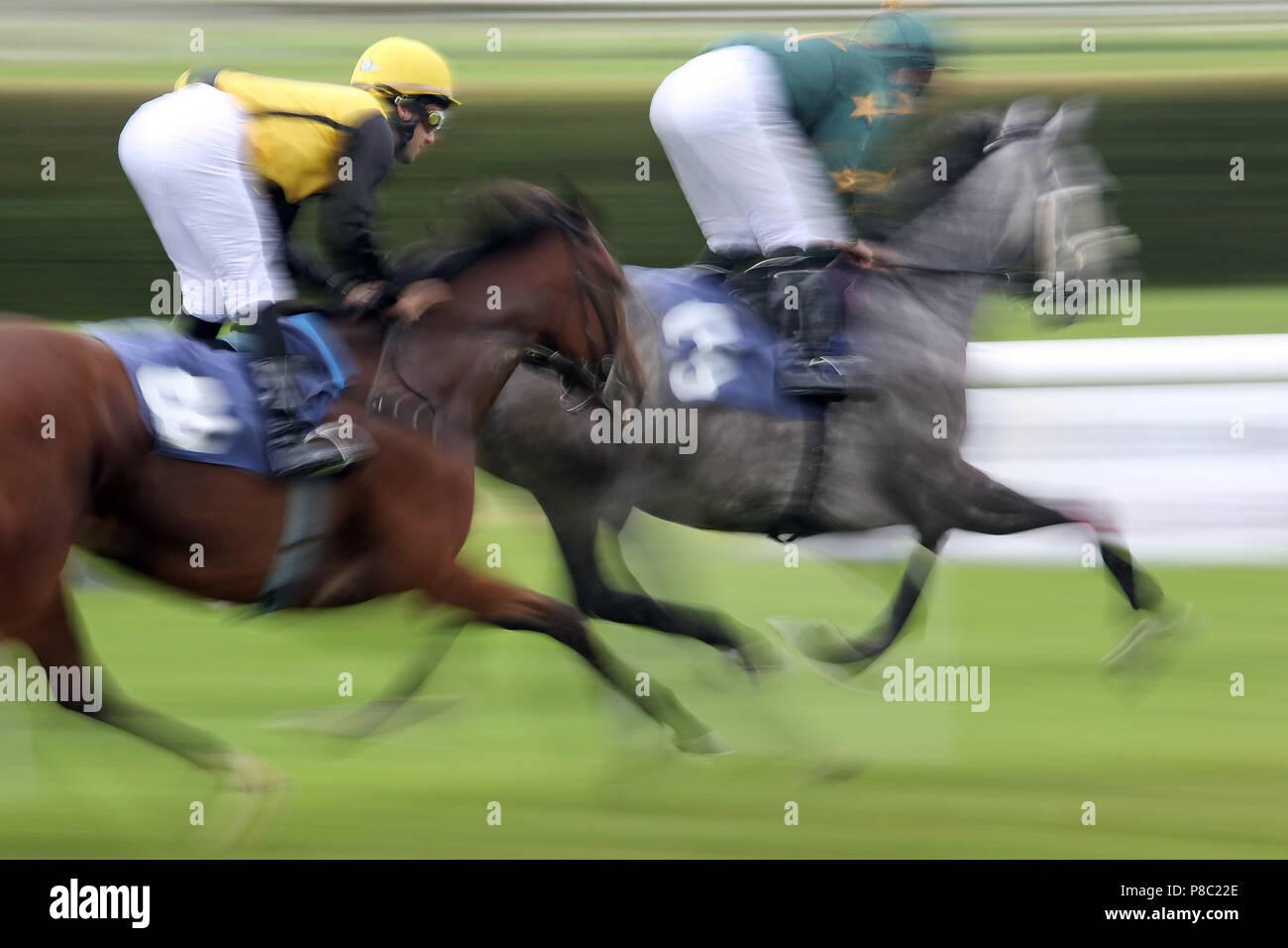 Iffezheim, dynamics, horses and jockeys in the race - Stock Image