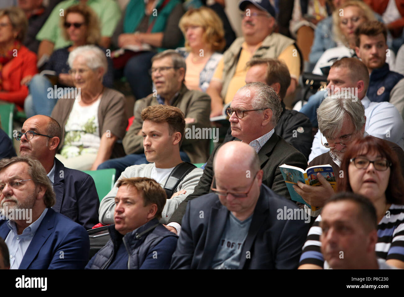 Iffezheim, interested in the BBAG annual auction - Stock Image