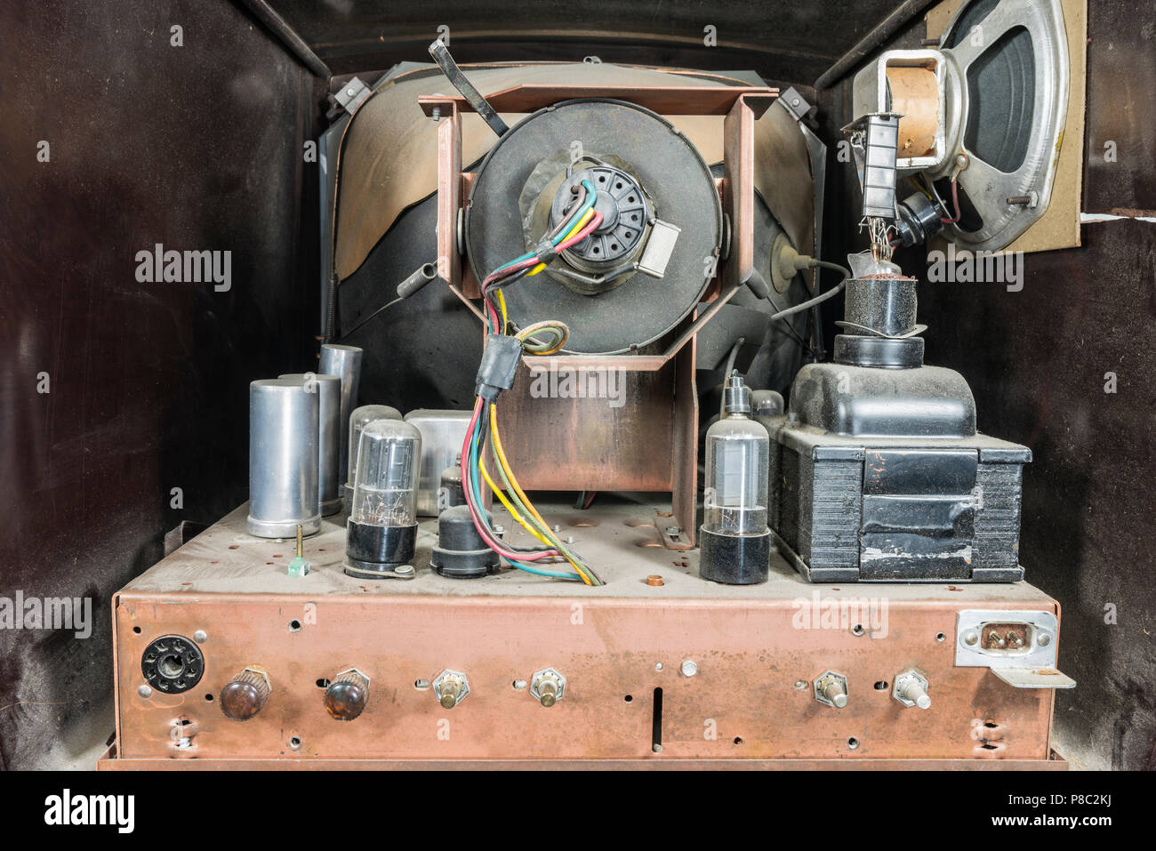 View inside dirty grungy vintage 1950s tube television set. - Stock Image