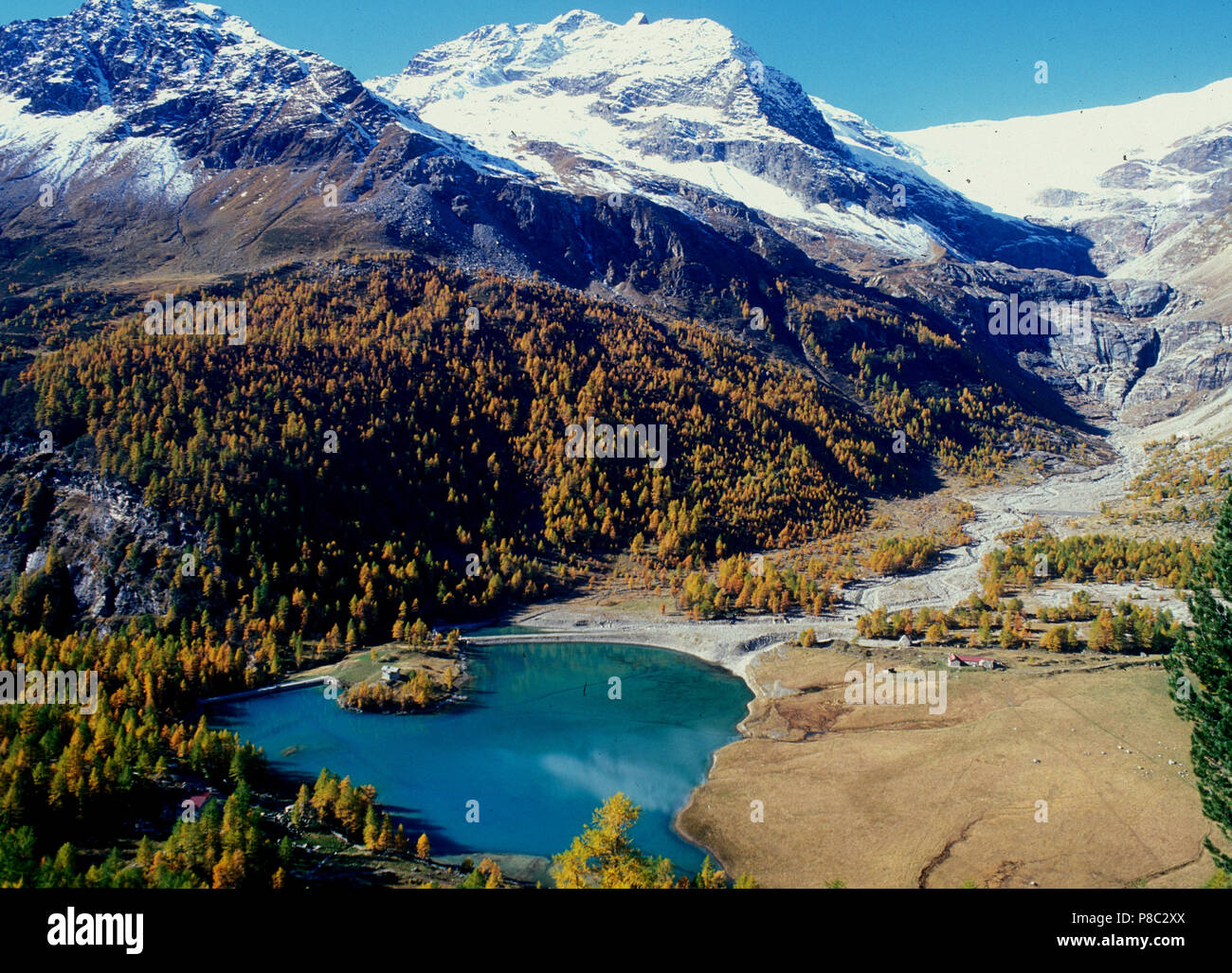 Swiss alps: Panoramic mountain and glacier lake view from Alp Grüm on Bernina Pass in the upper Engadin, - Stock Image