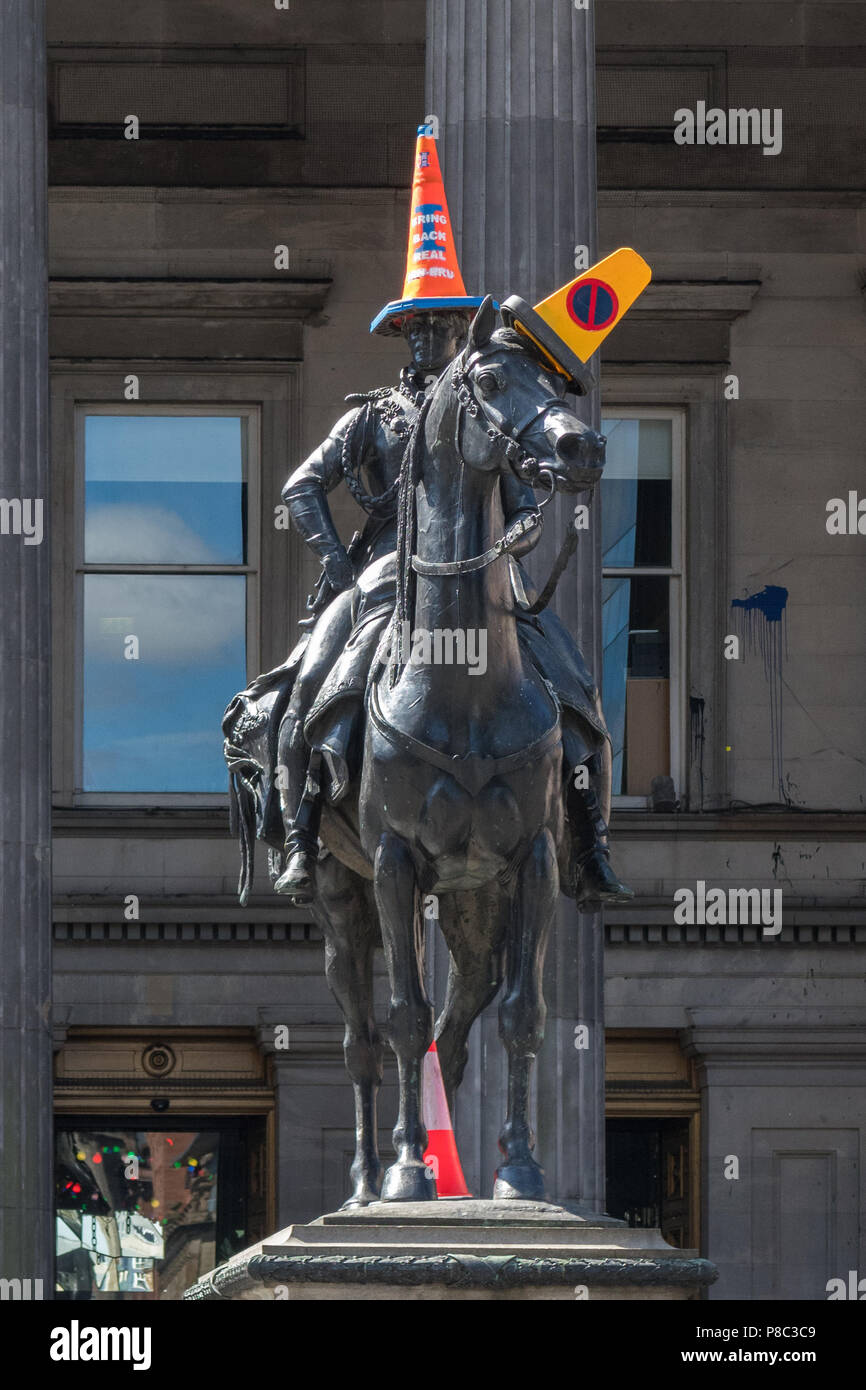 Sugar Tax protest - 'Bring Back real Irn Bru' cone on Duke of Wellington Statue, Glasgow, Scotland, UK - protest about reduced sugar Irn Bru - Stock Image
