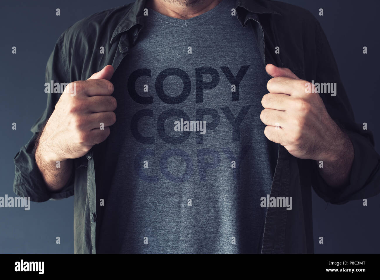 Copycat and plagiarism concept, repeating word Copy is fading on guy's t-shirt - Stock Image