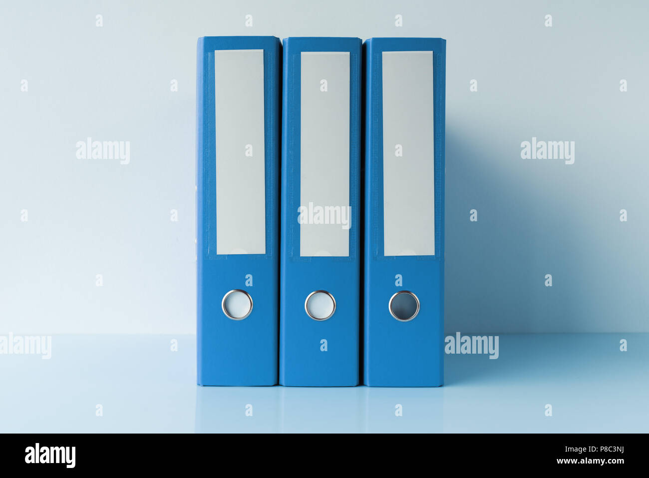 Blue file document ring binders in accountant and bookkeeping business office - Stock Image