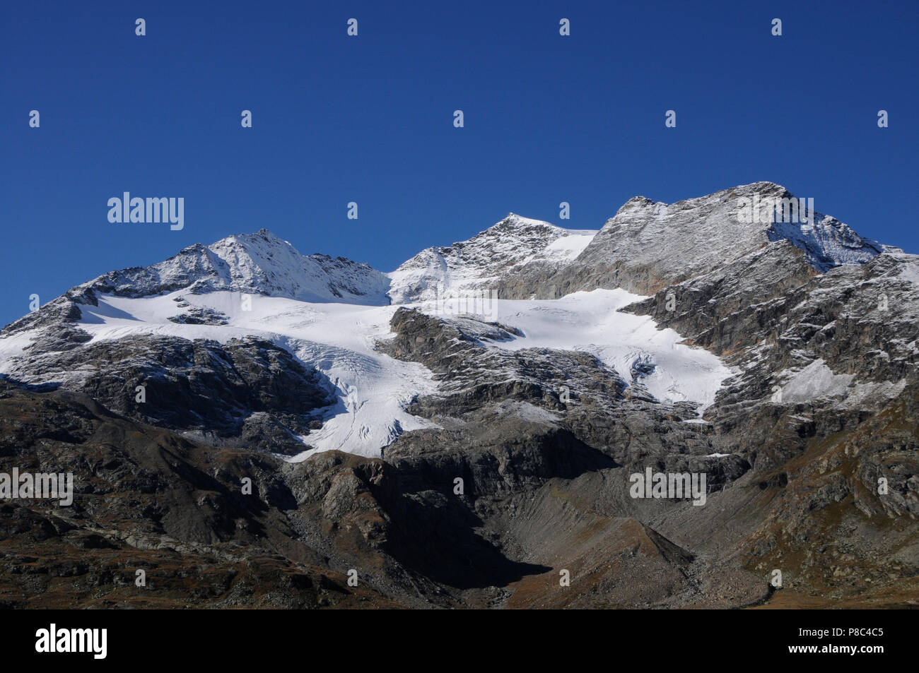 Swiss Alps: Melting glaciers and permafrost at Bernina mountains in the upper engadin - Stock Image