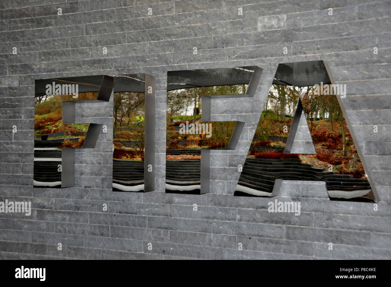 The Logo of the FIFA reflecting automn colours at the Headquarter in Zürich-City - Stock Image