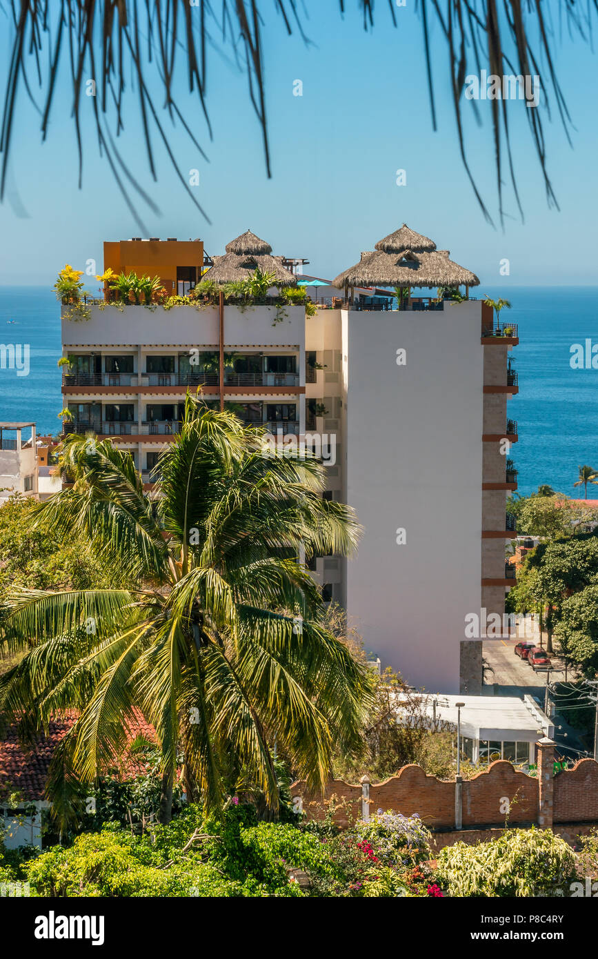 PUERTO VALLARTA, MEXICO - MARCH 10, 2018 - A  colorful view of a rooftop patio lounge and sky bar in Puerto Vallarta with the ocean in the background  - Stock Image