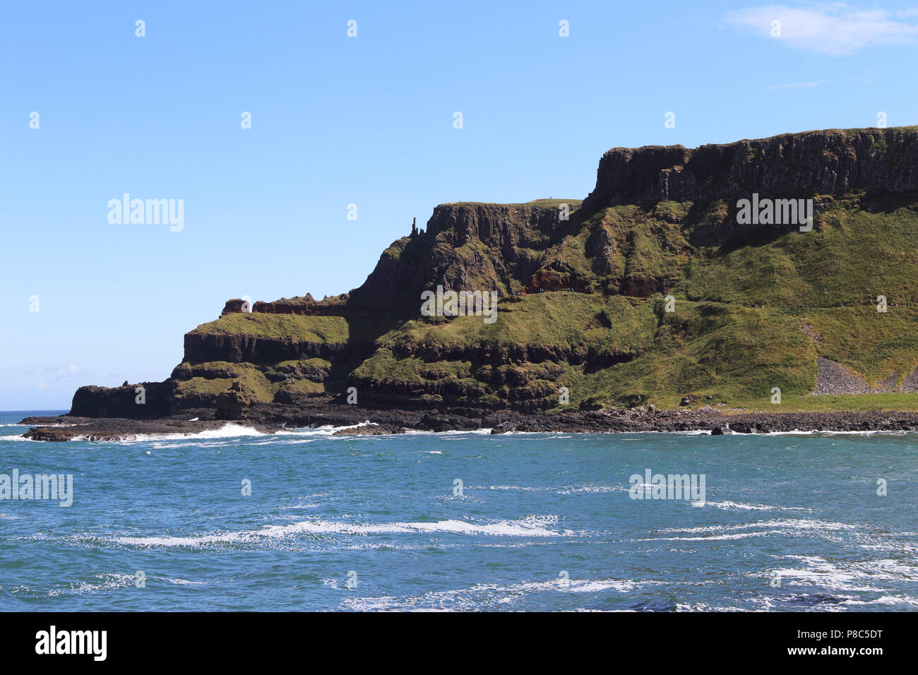 The Giant's Causeway is an area of about 40,000 interlocking basalt columns, the result of an ancient volcanic fissure eruption. It is located in Coun - Stock Image
