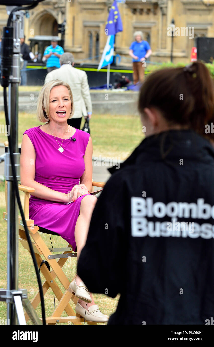 Caroline Hyde, business anchor for Bloomberg Business TV, broadcasting from College Green, Westminster, London, July 2018 - Stock Image