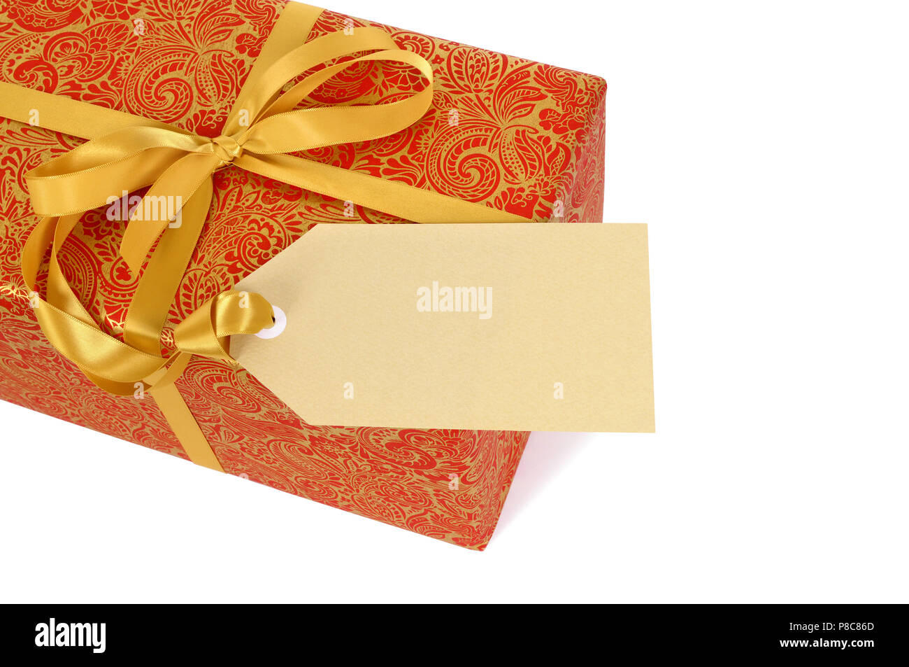 red and gold gift with ribbon and gift tag label isolated on white