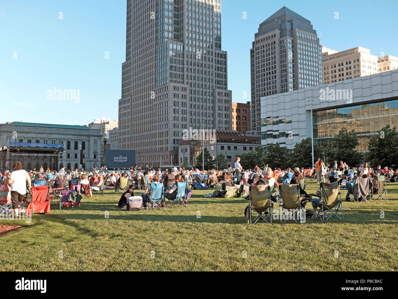 Downtown cleveland ohio usa stock photos downtown cleveland ohio people relax on the mall b grassy knoll waiting for a free summer concert by the publicscrutiny Images